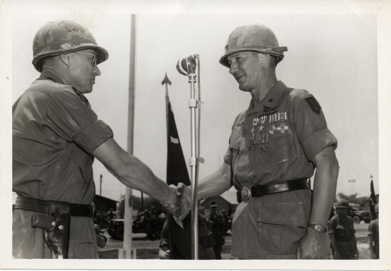Major General Keith Ware presents Brigadier General William S. Coleman with awards.